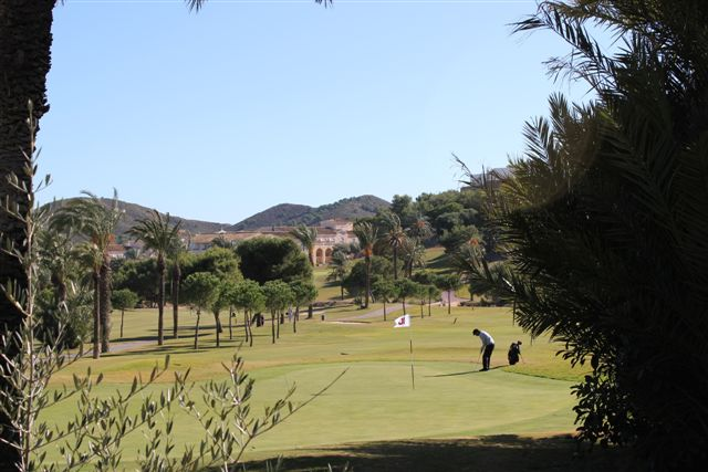 Putting on the first green on the La Manga Golf course